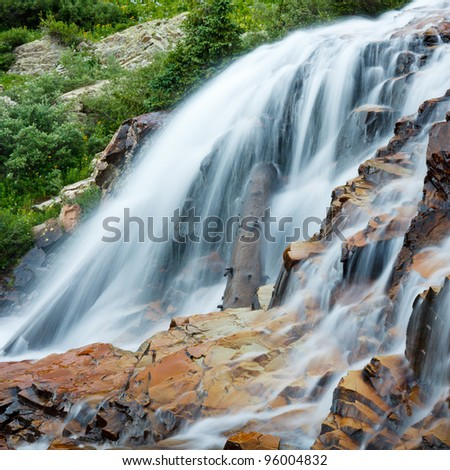 Cascading waterfall in the Rocky Mountains, Colorado. - stock photo