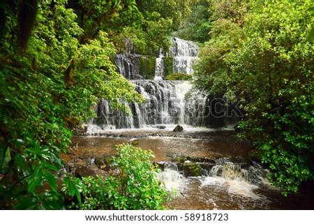 Cascading waterfall on the Purakaunui River in the South Island of New Zealand - stock photo
