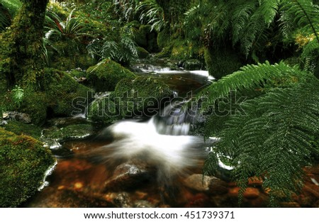 Cascading Waterfall Pancake Rocks Concept - stock photo