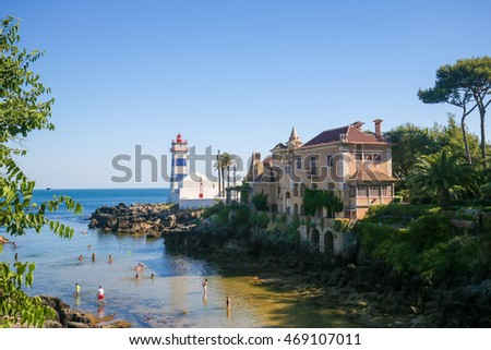 CASCAIS, PORTUGAL - JULY 15, 2016: The Farol de Santa Marta and the Casa de Santa Maria in Cascais, a Portuguese coastal town 30 km west of Lisbon.