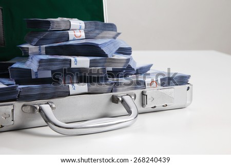 Case full of dollar on white background - stock photo