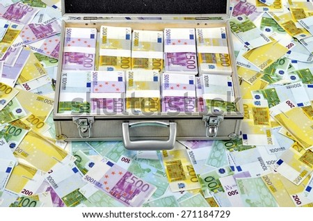 Case full of euro banknotes on money background. Counterfeit euro notes - stock photo