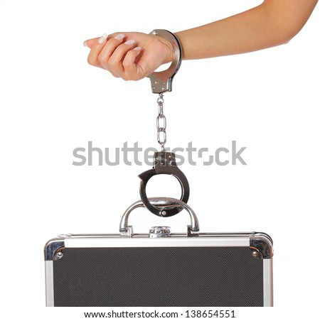 case of money in handcuffs with female hand, isolated on white. concert - stock photo
