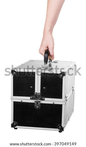 Case with professional makeup in a female hand isolated on white background. - stock photo