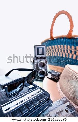 casette player with sunglasses and old twin-lens reflex camera - stock photo