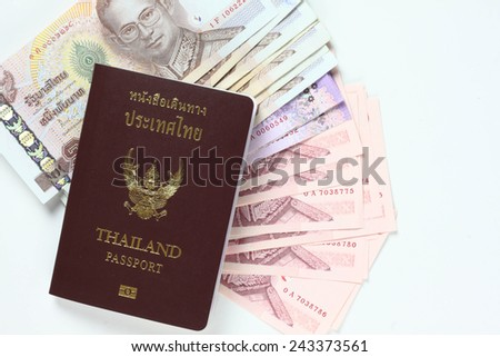 Cash and Thai passport isoled on White
