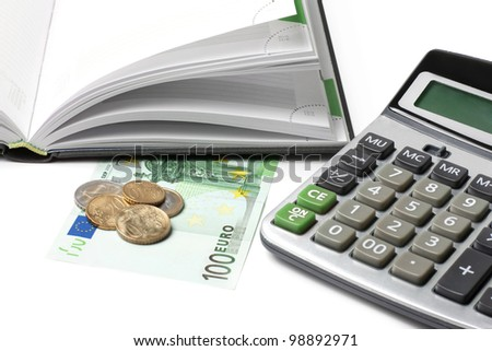 Cash, calculator, open diary isolated on white
