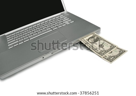 Cash coming out of a laptop. Make money with your computer online or the web. - stock photo