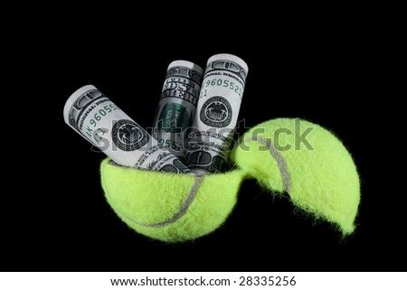 Cash coming out of a tennis ball. - stock photo