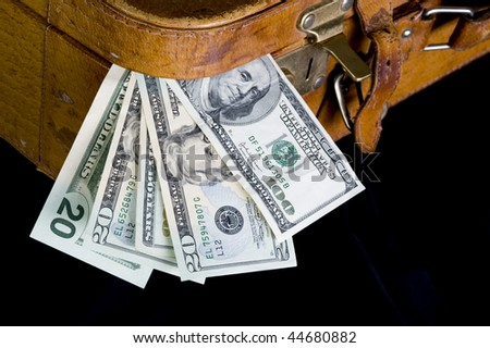 Cash ,dollar sticking out of overfilled case