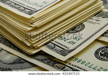Cash dollars in various denominations on the plane. - stock photo