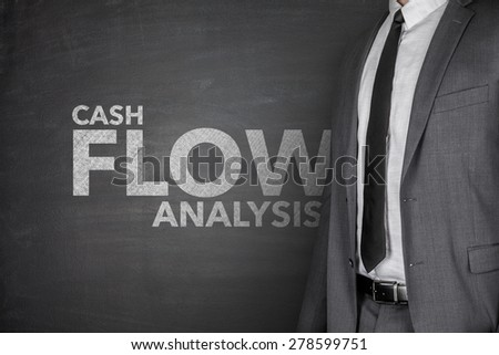 Cash flow analysis on black blackboard with businessman