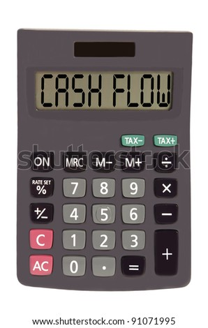 cash flow on display of an old calculator on white background - stock photo