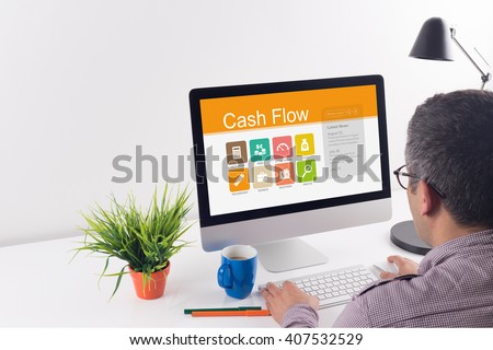 Cash Flow screen on the workplace - stock photo