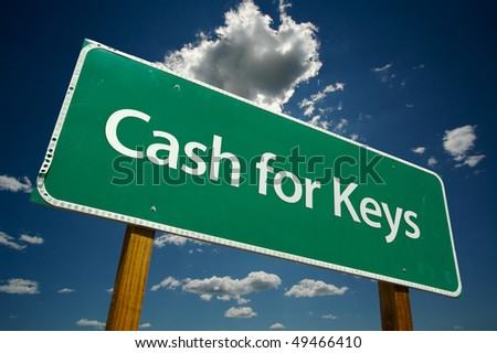 Cash for Keys Green Road Sign on Dramatic Blue Sky with Clouds. - stock photo