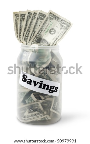 "Cash jar overflowing with US Dollar Bills and a sign that says ""Savings"". Studio shot isolated on white background, saved with clipping path - stock photo"