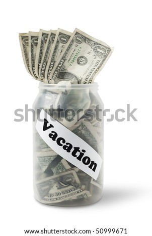 "Cash jar overflowing with US Dollar Bills and a sign that says ""Vacation"". Studio shot isolated on white background, saved with clipping path - stock photo"