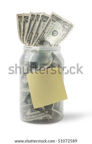 Cash jar overflowing with US Dollar Bills and a yellow sticky note. Studio shot isolated on white background, saved with clipping path - stock photo