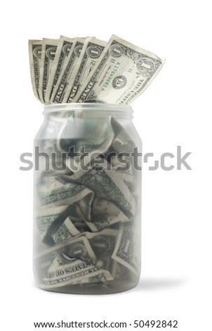 Cash jar overflowing with US Dollar Bills. Studio shot isolated on white background,  saved with clipping path - stock photo