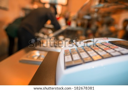 Cash Machine on a food shop. - stock photo