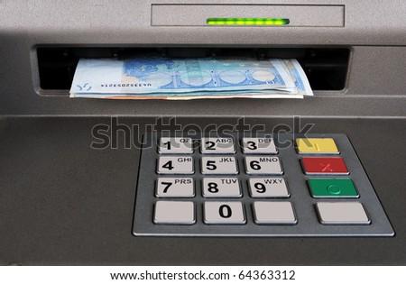 Cash machine with Euros - stock photo
