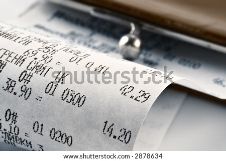 Cash receipt illustrating the spent money on background of a purse - stock photo
