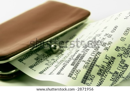 Cash receipt on background of a purse-how to spend money without damage to the family budget - stock photo