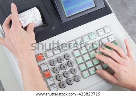 Cash Register and euro money in the till - stock photo