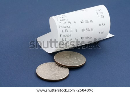cash register receipt and us dollar close up shot - stock photo
