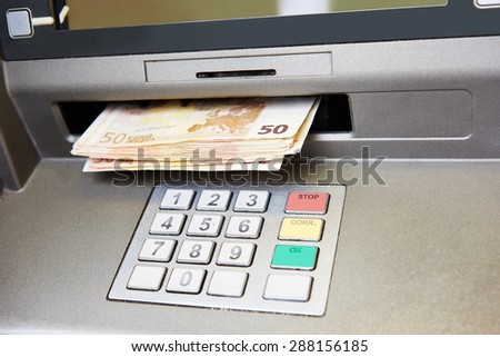 Cash withdrawal. Euro banknotes in ATM  - stock photo
