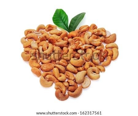 Cashew nuts in form of heart with leaves isolated on white background - stock photo
