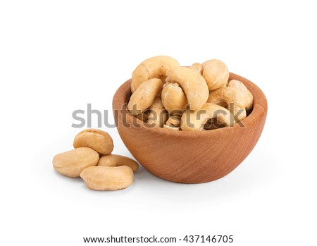 cashew nuts in wooden bowl isolated on white background - stock photo