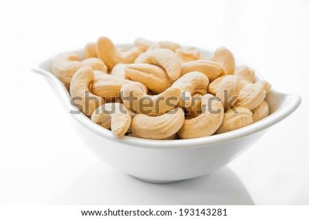 cashew nuts on white dish - stock photo