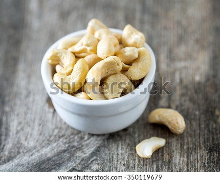 cashew nuts on wooden surface - stock photo