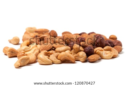 Cashews, hazelnuts and almonds on white background