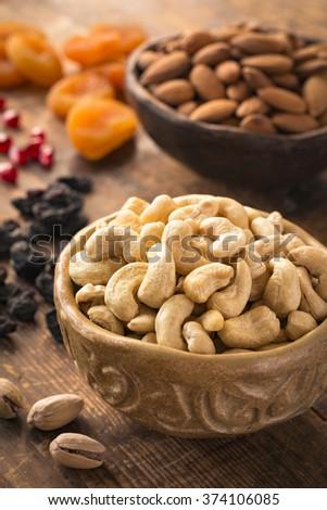 Cashews, pistachios, almonds, raisins, pomegranate seeds and dried apricots. Turkish dried fruits and nuts. Variety of dried fruits and nuts - stock photo