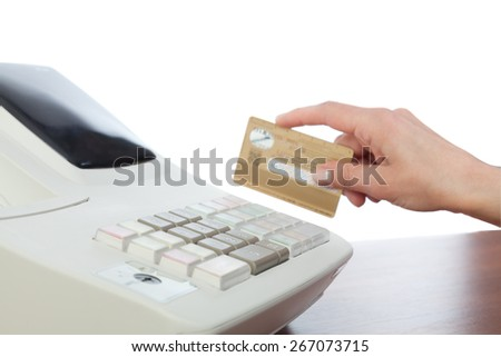 Cashier Holding Credit Card in Cash Register - stock photo