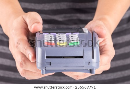 Cashier Holding Credit Card Machine - stock photo