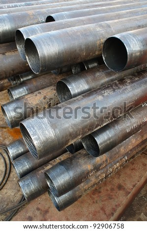 Casing stack laying on the deck before running in the oil well - stock photo