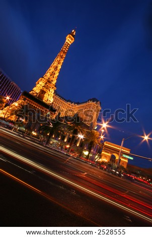 Casino at Night in Las Vegas with Blurred Traffic - stock photo