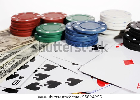 Casino chips and American money on the white background