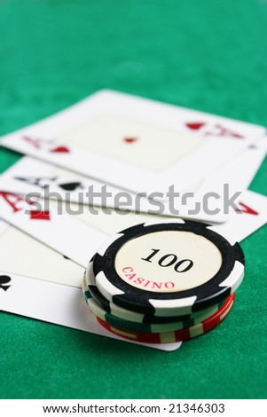 Casino chips and cards. Shallow DOF! - stock photo