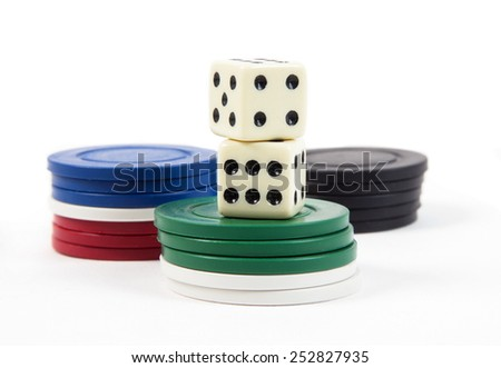 casino chips and dices on the white - stock photo