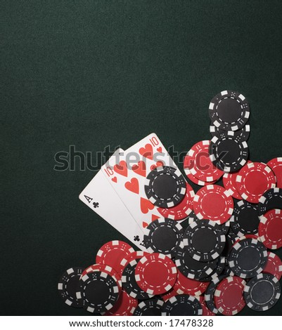 Casino chips on a green background and texas holdem poker cards in Vegas