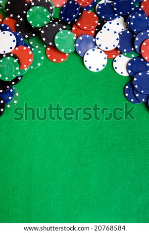 Casino chips on a green felt - background image - stock photo