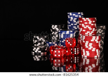 Casino chips on black background - stock photo