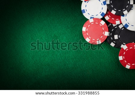 Casino chips on the green table - stock photo