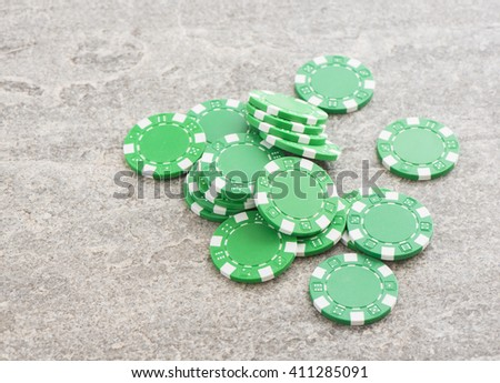 Casino chips pile for gambling and betting in poker. Symbol of luck, chance, winning money and entertainment. - stock photo