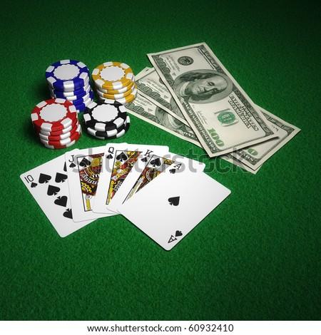 Casino chips, Royal Flush and US dollars - stock photo