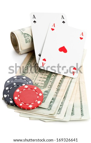 Casino chips with pocket aces on dollar bills on white background - stock photo